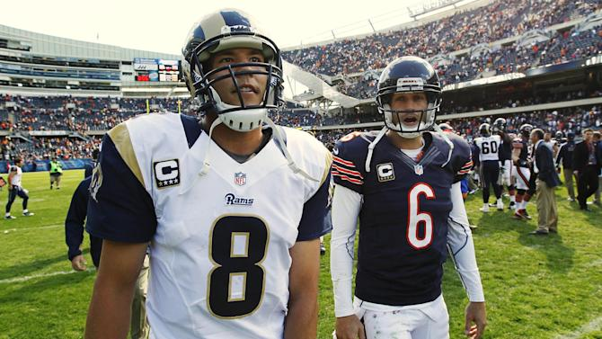 Chicago Bears quarterback Jay Cutler (6) and St. Louis Rams quarterback Sam Bradford (8) leave the field after the Bears' 23-6 win over the Rams in an NFL football game in Chicago, Sunday, Sept. 23, 2012. (AP Photo/Charles Rex Arbogast)