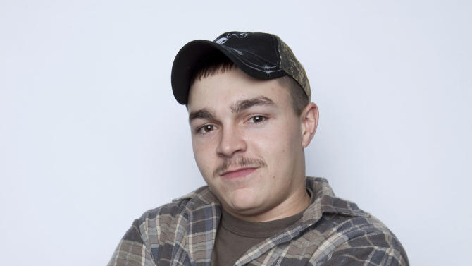 "FILE - This Jan. 2, 2013 file photo shows Shain Gandee, from MTV's ""Buckwild"" reality series in New York. Gandee was found dead Monday, April 1,  in a sport utility vehicle in a ditch along with his uncle and a third, unidentified person, authorities said. Kanawha County Sheriff's Department Cpl. B.D. Humphreys said the bodies of cast member, Shain Gandee, 21, his uncle David Gandee, 48, and the third person were found Monday near Sissonville.  (Photo by Amy Sussman/Invision/AP, file)"
