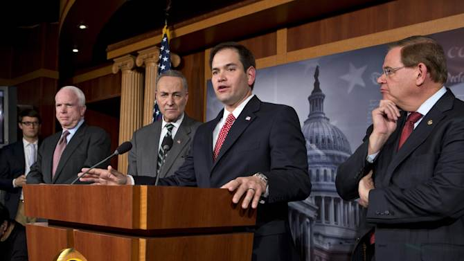 A bipartisan group of leading senators announce that they have reached agreement on the principles of sweeping legislation to rewrite the nation's immigration laws, during a news conference at the Capitol in Washington, Monday, Jan. 28, 2013. From left are Sen. John McCain, R-Ariz., Sen. Charles Schumer, D-N.Y., Sen. Marco Rubio, R-Fla., and Sen. Robert Menendez, D-N.J. The deal covers border security, guest workers and employer verification, as well as a path to citizenship for the 11 million illegal immigrants already in this country.  (AP Photo/J. Scott Applewhite)