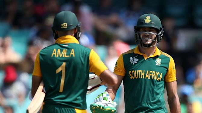 South Africa's Francois Du Plessis, right, hands teammate Hashim Amla is shoe that came off while batting during their Cricket World Cup Pool B match against the West Indies in Sydney, Australia, Friday, Feb. 27, 2015. (AP Photo/Rick Rycroft)