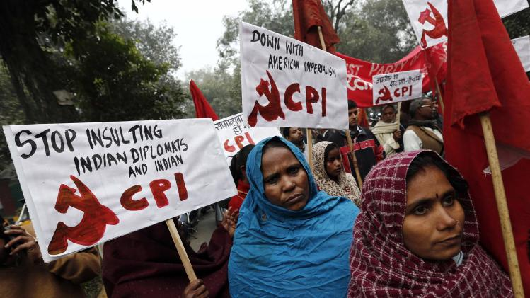 Supporters of CPI hold placards during a protest near the American Center in New Delhi