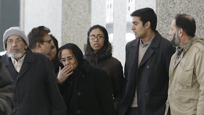 Family members and supporters of Chicago businessman Tahawwur Rana leave after Rana's sentencing in federal court Jan. 17, 2013 in Chicago. U.S. District Court Judge Harry D. Leinenweber sentenced Rana to 14 years for his role in aiding a terrorist group that took credit for the deadly 2008 attacks in Mumbai, India. Rana was cleared in 2011 of involvement in the Mumbai siege that killed more than 160 people, but he was convicted of lesser charges. They included providing material support to a Pakistani militant group that took responsibility for the Mumbai attack and a planned attack in Denmark. (AP Photo/M. Spencer Green)