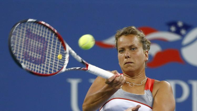 Barbora Zahlavova Strycova of the Czech Republic returns a shot to Eugenie Bouchard of Canada during their women's singles match at the 2014 U.S. Open tennis tournament in New York