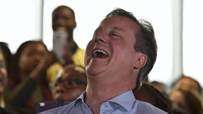 Britain's Prime Minister David Cameron laughs as London Mayor Boris Johnson speaks during an election rally in Hendon in north London
