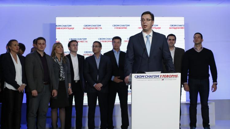 SNS leader Vucic addresses the media at the party's headquarters in Belgrade