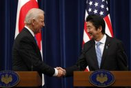 U.S. Vice President Joe Biden (L) shakes hands with Japan's Prime Minister Shinzo Abe at the end of their joint news conference following their meeting at the prime minister's official residence in Tokyo December 3, 2013. REUTERS/Toru Hanai