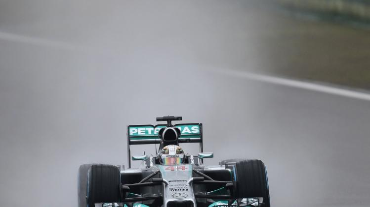 Mercedes Formula One driver Lewis Hamilton of Britain drives during the third practice session of the Chinese F1 Grand Prix at the Shanghai International circuit