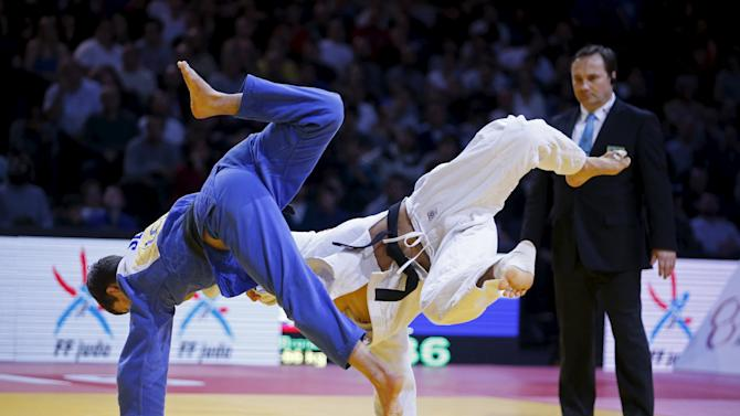 Jereb of Slovenia fights with South-Korea's An Baul in their men's under 66kg bronze medal match at the Paris International Grand Slam judo tournament