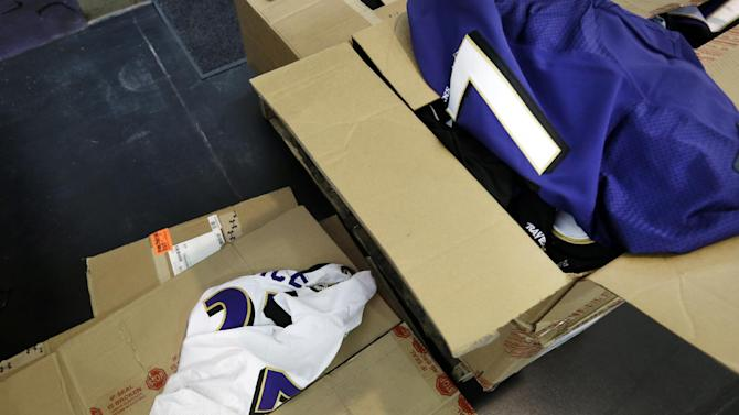 Former Baltimore Ravens running back Ray Rice jerseys that fans traded in sit strewn atop cardboard boxes, Friday, Sept. 19, 2014, at M&T Bank Stadium in Baltimore. The Ravens offered fans a chance to exchange their Rice jerseys for those of another player after he was cut by the team and suspended indefinitely by the NFL for domestic violence