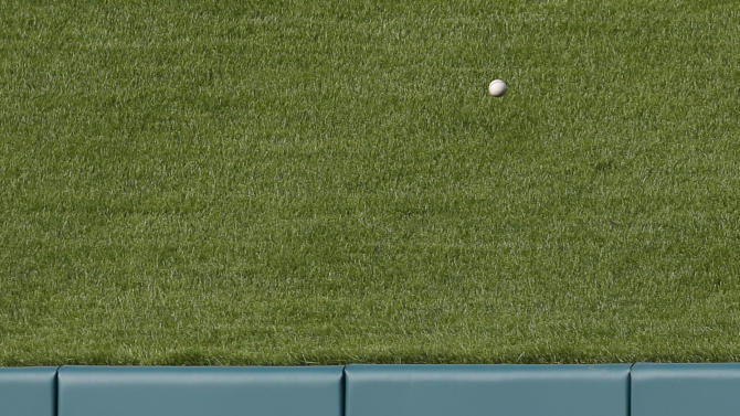 St. Louis Cardinals center fielder Peter Bourjos watches a ball hit for a two-run home run by Arizona Diamondbacks' Mark Trumbo lands over the outfield wall during the eighth inning of a baseball game Monday, May 25, 2015, in St. Louis. (AP Photo/Jeff Roberson)