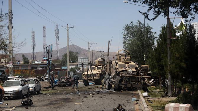 Afghan security forces work at the site of a blast targeting a NATO convoy in Kabul, Afghanistan, Tuesday, June 30, 2015. It comes a week after an audacious attack on the nation's parliament, which highlighted the ability of insurgents, who have been fighting to overthrow the Kabul government for almost 14 years, to enter the highly fortified capital to stage deadly attacks. (AP Photo/Massoud Hossasini)