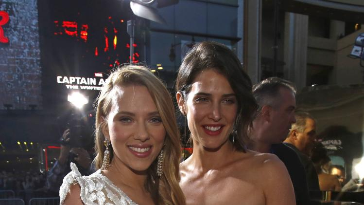 "Cast members Johansson and Smulders pose at the premiere of ""Captain America: The Winter Soldier"" in Hollywood"