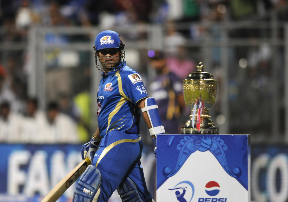 Sachin Tendulkar of Mumbai Indians has a closer look at the IPL trophy as he walks to bat during match 53 of the Pepsi Indian Premier League ( IPL) 2013  between The Mumbai Indians and the Kolkata Kni