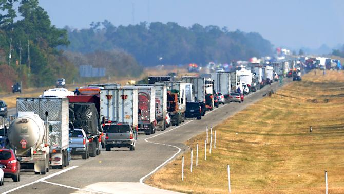 Traffic backs up on the east bound lane of Interstate 10 on Thanksgiving day Nov. 22, 2012 after a multi-vehicle accident in Southeast,Texas.  The Texas Department of Public Safety says at least 35 people have been injured in a more than 50-vehicle pileup that forced the closure of Interstate 10. (AP Photo/The Beaumont Enterprise, Guiseppe Barranco)  MANDATORY CREDIT Guiseppe Barranco/The Enterprise