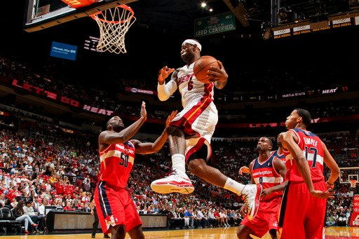 MIAMI, FL - JANUARY 6: LeBron James #6 of the Miami Heat drives to the basket against Emeka Okafor #50 of the Washington Wizards on January 6, 2013 at American Airlines Arena in Miami, Florida. (Photo by Issac Baldizon/NBAE via Getty Images)