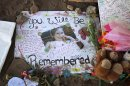 "A poster in memory of Veronica Moser-Sullivan, 6, is shown at the memorial to victims of the Aurora, Colo., movie theater shooting, Friday, July 27, 2012. It was a week ago Friday that a gunman opened fire during a late-night showing of ""The Dark Knight Rises"" Batman movie, killing 12 and injuring dozens of others. Police have identified the suspected shooter as James Holmes, 24. (AP Photo/Ted S. Warren)"