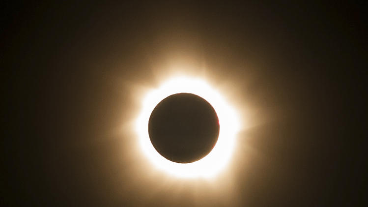 Clouds part, solar eclipse darkens north Australia