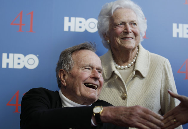 "FILE - In a Tuesday, June 12, 2012 file photo, former President George H.W. Bush, and his wife, former first lady Barbara Bush, arrive for the premiere of HBO's new documentary on his life near the family compound in Kennebunkport, Maine. The 41st president will spend Christmas in a Houston hospital after developing a fever and weakness following a monthlong, bronchitis-like cough. Bush's spokesman Jim McGrath said Monday, Dec. 24, 2012, that doctors remain ""cautiously optimistic"" that he will recover, but they want to keep him in the hospital. (AP Photo/Charles Krupa, File)"