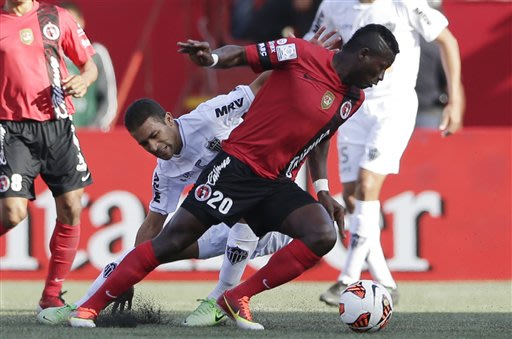 Duvier Riascos (20) of Mexico's Club Tijuana Xoloitzcuintles changes directions as Lucas Pierre of Brazil's Atletico Mineiro defends during the first half of their Copa Libertadores quarterfinal socce