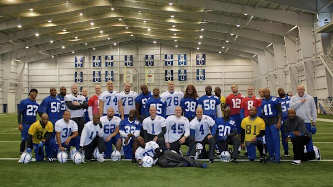 In this photo provided by the Indianapolis Colts, member of the Colts NFL team pose together in Indianapolis, Wednesday, Nov. 7, 2012. The Colts are going to great lengths to support their ailing coach Chuck Pagano. In a show of support, many players shaved their heads after Tuesday's practice. Pagano lost his hair while undergoing treatment for leukemia. (AP Photo/Indianapolis Colts)