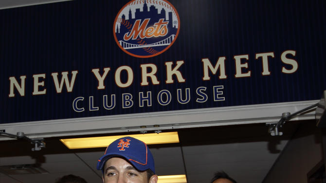 "New York Mets relief pitcher Tim Byrdak holds ""Little Jerry Seinfeld,"" the chicken that he brought into the clubhouse before handing it off to representatives of the Farm Sanctuary of Watkins Glen, N.Y., before the Mets faced the New York Yankees in their interleague baseball game at Citi Field in New York, Sunday, June 24, 2012. (AP Photo/Kathy Willens)"