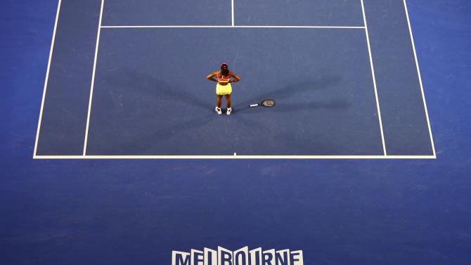 Williams of the U.S. reacts at a let call on championship points as she serves to Sharapova of Russia during their women's singles final match at the Australian Open 2015 tennis tournament in Melbourne