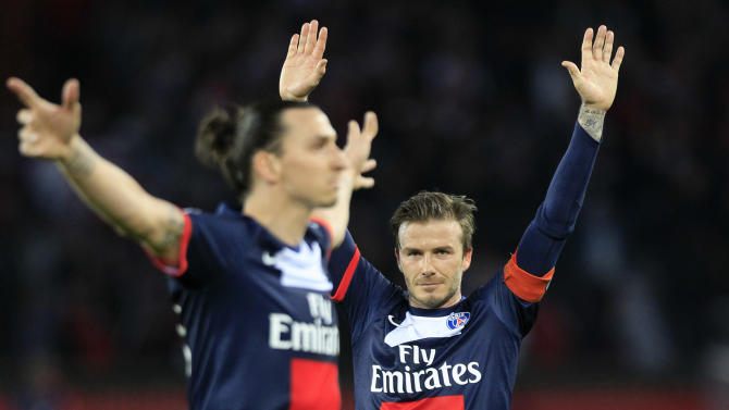 Paris Saint Germain's midfielder David Beckham from England, right, celebrates after Paris Saint Germain's forward Zlatan Ibrahimovic from Sweden, left, scores during their French League One soccer match against Brest, at the Parc des Princes stadium, in Paris, Saturday, May 18, 2013. Paris Saint-Germain hopes to strike a deal with David Beckham in the next two weeks in which the former England captain will work with the French club after retirement, possibly in an ambassadorial role. (AP Photo/Thibault Camus)