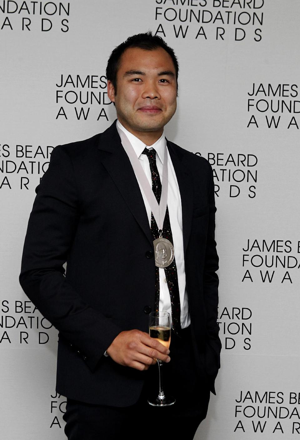 Chef Paul Qui poses with his medal for Best Chef: Southeast, during the James Beard Foundation Awards, Monday, May 7, 2012, in New York. (AP Photo/Jason DeCrow)