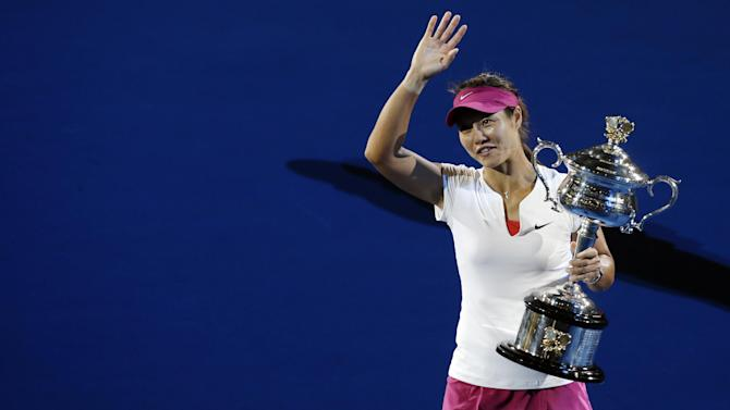 FILE - In this Jan. 25, 2014, file photo, Li Na, of China, walks around during the trophy presentation after defeating Dominika Cibulkova, of Slovakia, in the women's singles final at the Australian Open tennis championship in Melbourne, Australia. Li formally announced her retirement on Friday, Sept. 19, 2014. (AP Photo/Aijaz Rahi, File)