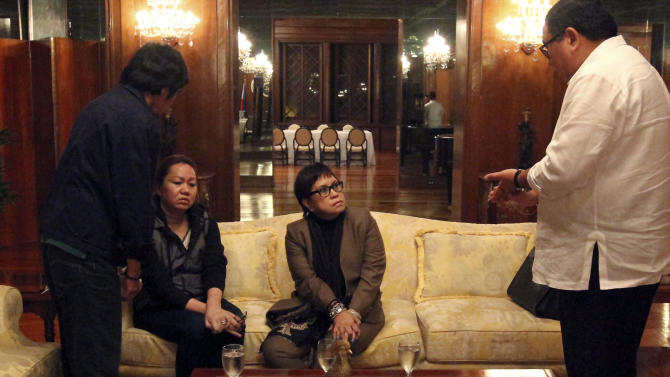 Woman tied to Philippine graft scandal surrenders