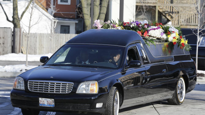 A hearse carrying the casket of Hadiya Pendleton waits outside the Greater Harvest Missionary Baptist Church on Saturday, Feb. 9, 2013, in Chicago. Hundreds of mourners and dignitaries including first lady Michelle Obama packed the funeral service Saturday for a Chicago teen whose killing catapulted her into the nation's debate over gun violence. (AP Photo/Nam Y. Huh)