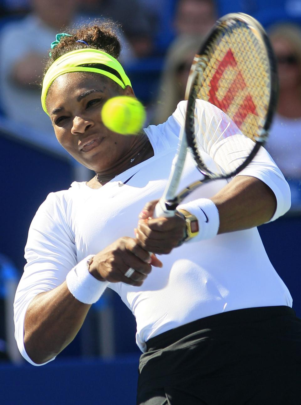 Serena Williams returns a serve against Angelique Kerber, from Germany, during a quarterfinal at the Western & Southern Open tennis tournament on Friday, Aug. 17, 2012, in Mason, Ohio. Kerber won 6-4, 6-4. (AP Photo/Al Behrman)