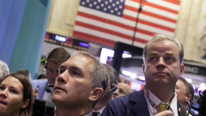 Traders Timothy Nick, left, and David O'Day work on the floor of the New York Stock Exchange Wednesday, Oct. 3, 2012. Stocks are mostly higher in early trading on Wall Street Wednesday after a measure of private sector hiring came in better than economists were expecting. (AP Photo/Richard Drew)