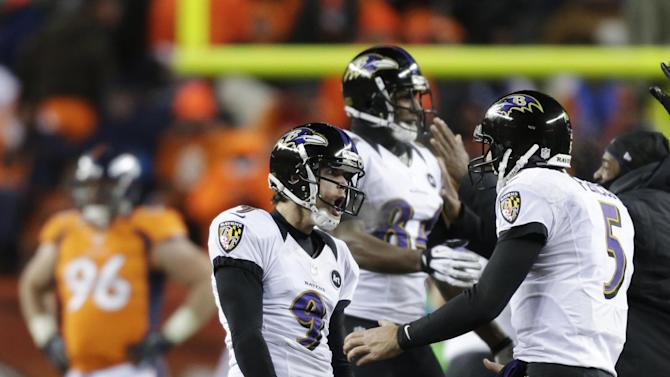 Baltimore Ravens kicker Justin Tucker (9) and quarterback Joe Flacco (5) celebrate after Tucker hit the game-winning field goal against the Denver Broncos in overtime of an AFC divisional playoff NFL football game, Saturday, Jan. 12, 2013, in Denver. The Ravens won 38-35. (AP Photo/Joe Mahoney)