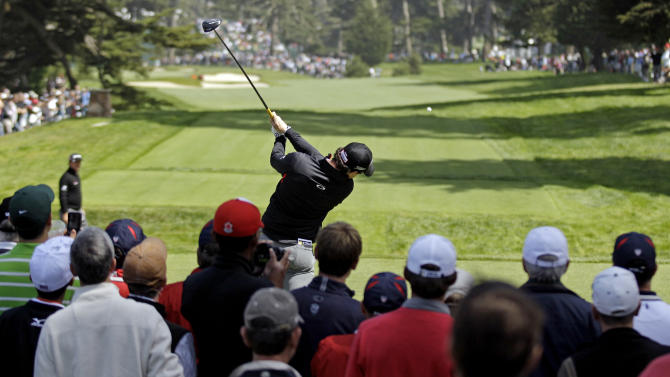 Rory McIlroy, of Northern Ireland, hits a drive on the sixth hole during a practice round for the U.S. Open Championship golf tournament Wednesday, June 13, 2012, at The Olympic Club in San Francisco. (AP Photo/Charlie Riedel)