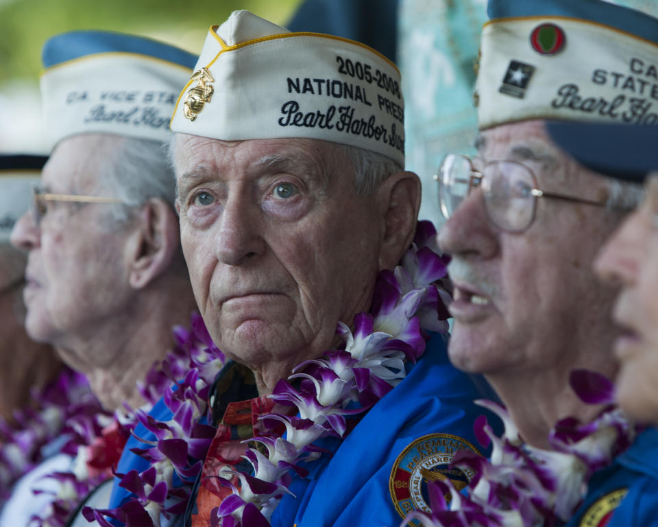 Pearl Harbor survivor Mal Middlesworth, center, sits with other Pearl Harbor survivors before the start of ceremony commemorating the 72nd anniversary of the attack on Pearl Harbor, Saturday, Dec. 7, 2013, in Honolulu. (AP Photo/Marco Garcia)