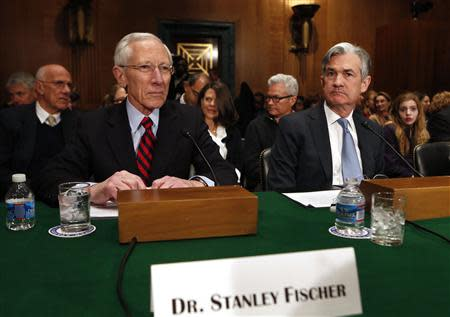Stanley Fischer, the former chief of the Bank of Israel, prepares to testify before the Senate Banking Committee confirmation hearing in Washington
