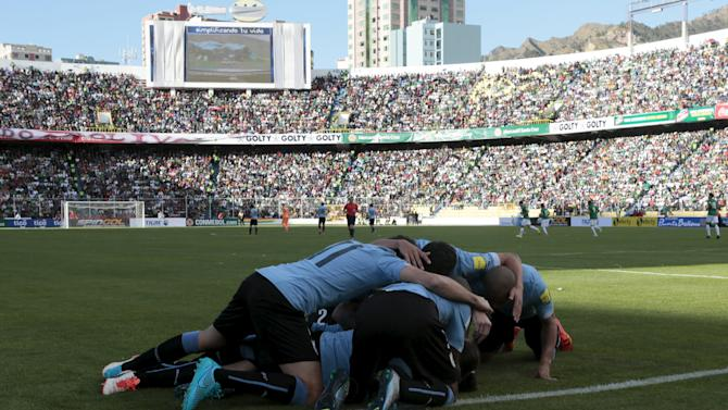 Players of Uruguay celebrate their team's second goal after teammate Diego Godin scored against Bolivia during their 2018 World Cup qualifying soccer match in La Paz