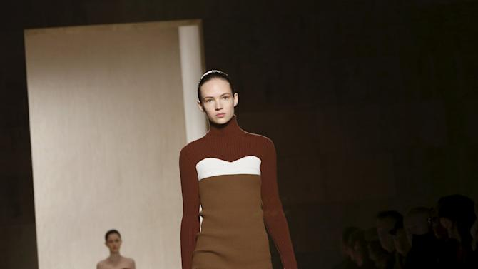 Models present creations from the Victoria Beckham Fall/Winter 2016 collection at New York Fashion Week.