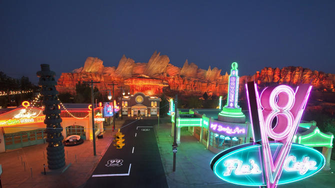 "This May 2012 photo released by Disneyland shows the new 12-acre Cars Land, a replica of Radiator Springs, the town in the popular ""Cars,"" film franchise at Disney California Adventure park at Disneyland Resort in Anaheim, Calif.  The park's five-year, $1 billion-plus revamp has debuted in spurts since 2008. Most of its new features rely on characters that come from Disney's $7.4 billion acquisition of Pixar Animation Studios, the San Francisco-area studio behind ""Cars,"" `'Toy Story,"" `'Monsters Inc."" and ""A Bug's Life.""  (AP Photo/Disneyland Resort, Paul Hiffmeyer)"