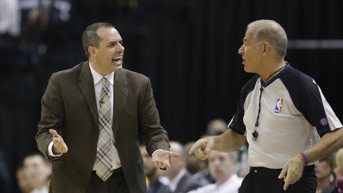 Indiana Pacers head coach Frank Vogel, left, argues a call with referee Bennett Salvatore during the first half of Game 5 in the first round of the NBA basketball playoff series against the Atlanta Hawks, Wednesday, May 1, 2013, in Indianapolis.  (AP Photo/Darron Cummings)