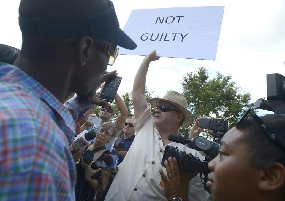 A man who would not provide his name, shows his support for George Zimmerman outside the Seminole County Courthouse in Sanford, Fla., Saturday, July 13, 2013. Zimmerman has been charged in the 2012 shooting death of Trayvon Martin.(AP Photo/Phelan M. Ebenhack)