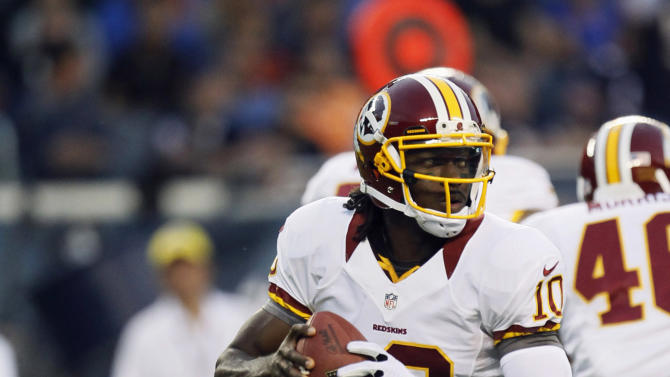Washington Redskins quarterback Robert Griffin III looks for a receiver in the first half of an NFL preseason football game against the Chicago Bears in Chicago, Saturday, Aug. 18, 2012. (AP Photo/Charles Rex Arbogast)