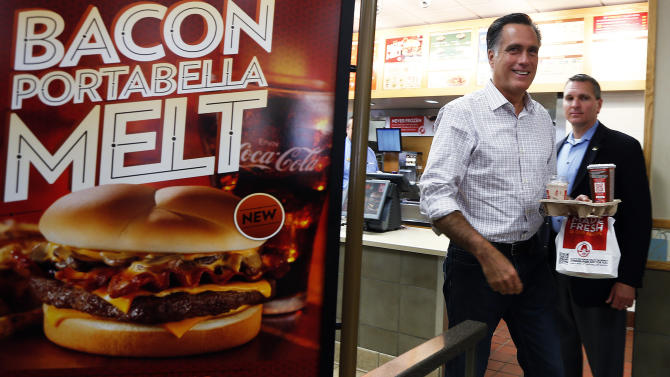 Republican presidential nominee Mitt Romney takes out his food from a  Wendy's restaurant in Cuyahoga Falls, Ohio