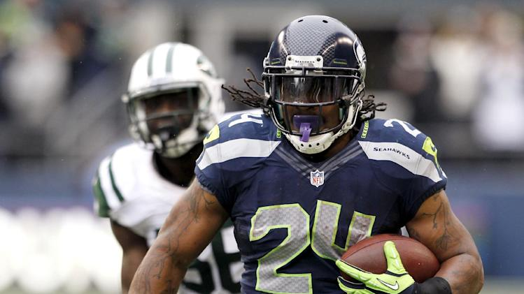 New York Jets' DeMario Davis trails Seattle Seahawks' Marshawn Lynch on a long run during the first half of an NFL football game, Sunday, Nov. 11, 2012, in Seattle. (AP Photo/Elaine Thompson)