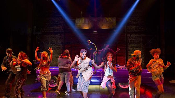 """FILE - This image released by Boneau/Bryan-Brown shows the cast performing in """"Holler If Ya Hear Me,"""" at the Palace Theatre in New York. Tupac Shakur fans, keep ya head up. Producers said late Monday, July 14, 2014, that the show will close Sunday at the Palace Theatre after playing just 17 previews and 38 regular performances. (AP Photo/Boneau/Bryan-Brown, Joan Marcus, file)"""