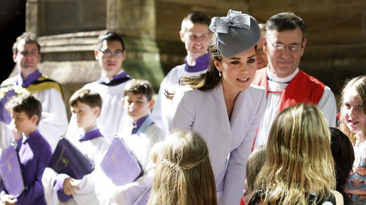 Britain's Catherine, Duchess of Cambridge, greets children following an Easter Sunday Service in Sydney