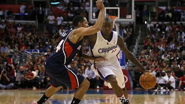 Jamal Crawford of the Los Angeles Clippers drives towards the basket while being defended by the Atlanta Hawks' Devin Harris (AFP)