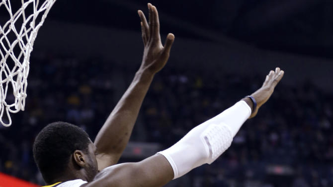 Chicago Bulls forward Luol Deng, right, attempts to shoot over Indiana Pacers center Roy Hibbert during the first half of an NBA basketball game in Indianapolis, Monday, Feb. 4, 2013. (AP Photo/Michael Conroy)