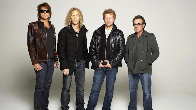 FILE - In this Nov. 29, 2012 file photo, American rock band Bon Jovi, from left, Richie Sambora, David Bryan, Jon Bon Jovi and Tico Torres pose for a portrait, in the Brooklyn Borough of New York. Drummer Torres' emergency appendectomy in Mexico City has forced Bon Jovi to postpone the Tuesday, Sept. 10, 2013 show in Mexico City after Torres checked into the American British Cowdary Hospital. Concert dates for Santiago, Chile, and Buenos Aires, Argentina, were also postponed and rescheduled for later this month. (Photo by Dan Hallman/Invision/AP, File)